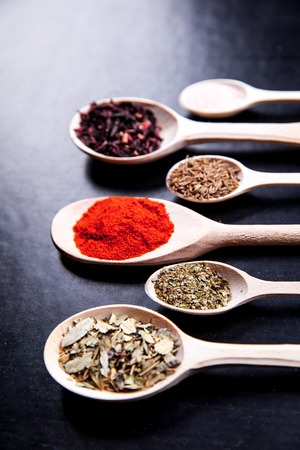 svan: spice in wood spoon on a black background. Stock Photo