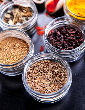svan: Spices on black background in special jars.