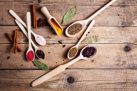 barberries: Spices on wooden background. With empty space for advertising text Stock Photo