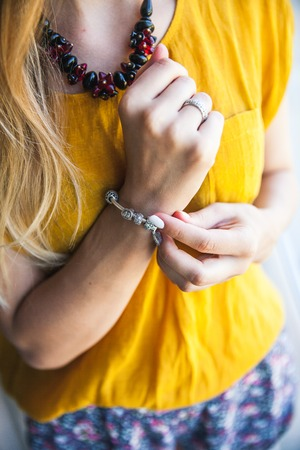 boasting: Close up of hands of woman showing the ring with diamond. She is engaged Stock Photo