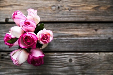 valentines day mother s: Pink roses on a wooden table. Vintage. flowers Stock Photo