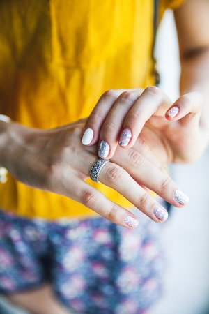 Close up of hands of woman showing the ring with diamond. She is engaged Stock Photo