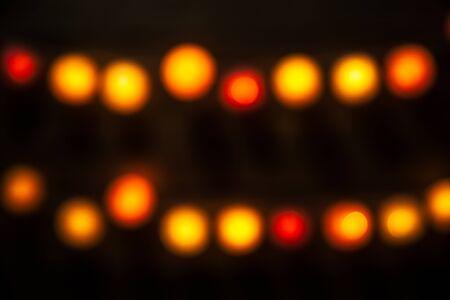 night vision: Blurry Christmas lights festive background.