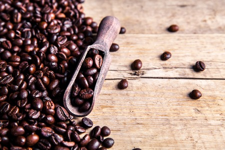 Coffee beans in wooden spoon, close up Stock Photo