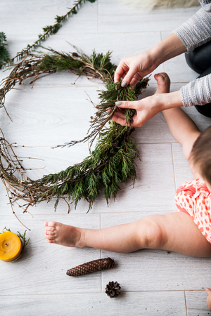 Little kids with mom make crafts for Christmas. Creativity, decoration. Stock Photo