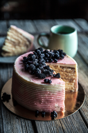Cake with a pink tint with blueberries