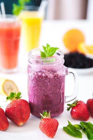Blueberry smoothies on a white  with berries