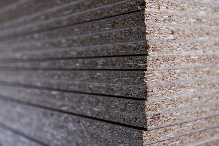 chipboard: Set in the manufacture of chipboard in low light