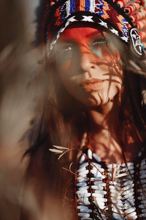 Beautiful girl in a suit of the American Indian. In Sunny day Stock Photo