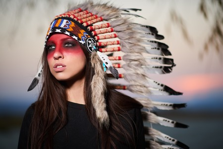 aboriginal woman: Beautiful girl in a suit of the American Indian. Stock Photo