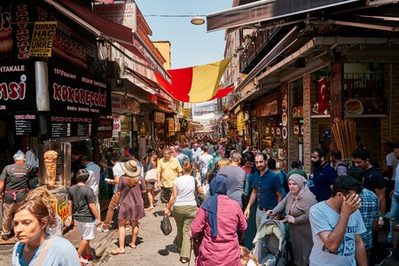ISTANBUL, TURKEY - JULY 28, 2015: Eminonu and Grand Bazaar is popular destination for tourists in Istanbul.