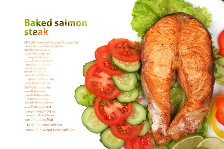 Baked salmon steak on a white background photo