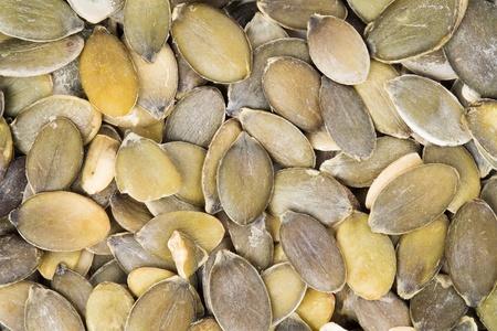 Background of peeled pumpkin seeds