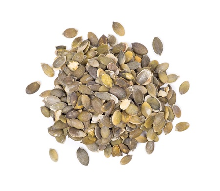 Peeled pumpkin seeds on a white background Stockfoto