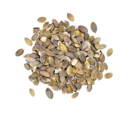 semillas de girasol: Semillas de calabaza peladas en un fondo blanco