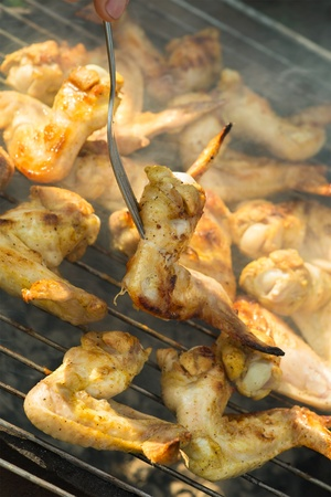 Cooking chicken wings on a picnic Stock Photo