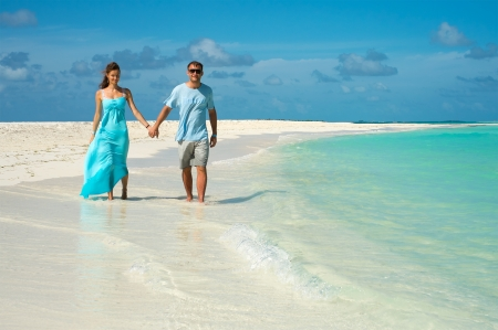 Honeymoon in the Maldives. Newlyweds go on a sand spit on the\ shores of the Indian Ocean.\