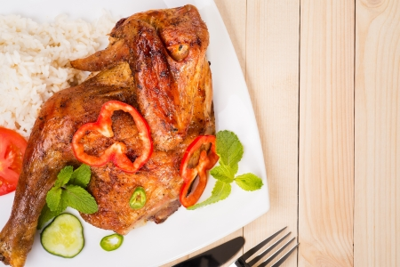 Roast chicken with fresh herbs and rice - background photo