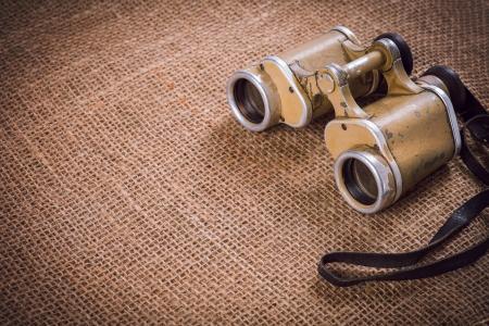 Old German military binoculars on canvas background Stockfoto