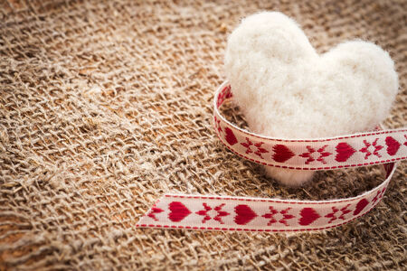 Heart made of wool. Background Stock Photo