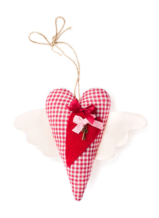 Textile heart with key on a white background. Handwork Stock Photo