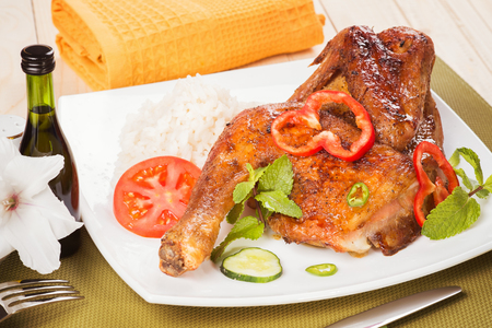 Appetizing baked chicken with fresh vegetables photo