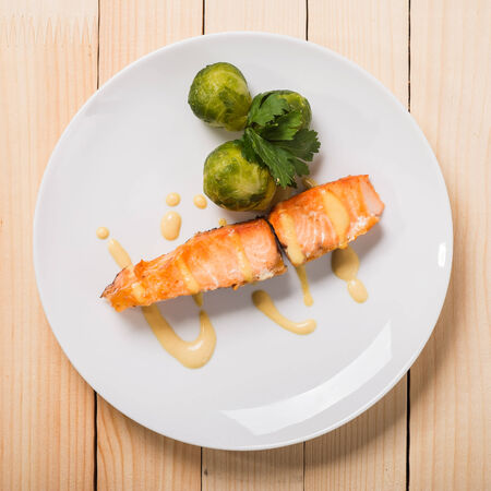 Baked trout with broccoli Stock Photo