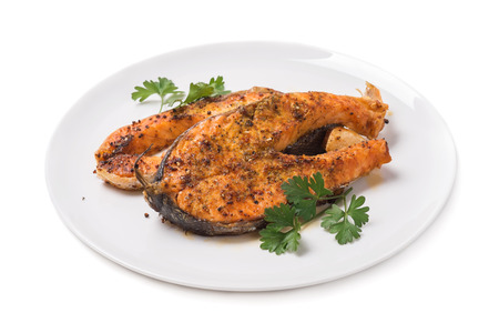 Baked trout on white background Stock Photo