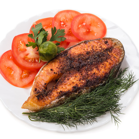 Slice of baked trout with vegetables Stock Photo