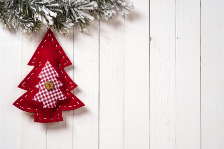 Christmas decoration with fir branches on the background of a tree with copy space
