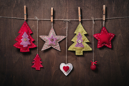 Christmas decorations on a background of wood. Crafts made of felt Stock Photo
