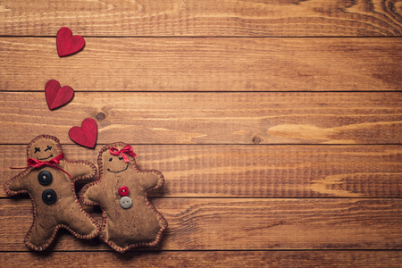 Textile toys in the shape of gingerbread on Valentines Day. Space for text photo