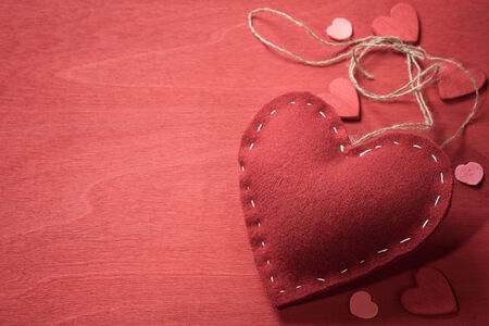 backcloth: Textile toy in the shape of heart on Valentines Day. Space for text Stock Photo