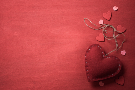 a place for the text: Top view of the textile toy in the shape of heart on Valentines Day and a place for text
