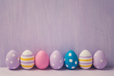 Colorful easter eggs, with space for text. Background Archivio Fotografico