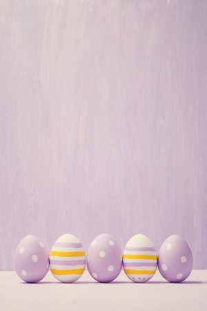 Colorful easter eggs. Background with easter eggs. With retro filter effect. Stock Photo