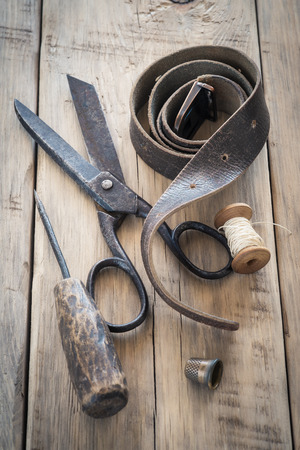 Homemade vintage tools on a wooden background