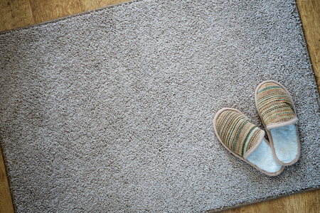 Slippers on the mat, top view with space for text Foto de archivo