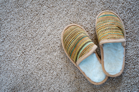 footware: Slippers on the mat, top view with space for text Stock Photo