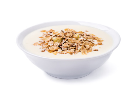 Muesli with yoghurt and fruit pieces isolated on white background Stockfoto