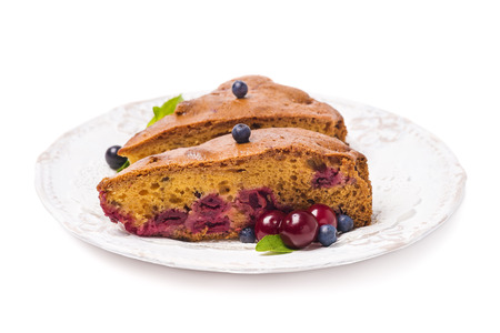 homemade cake: Homemade cake with cherries and blueberries on a white background