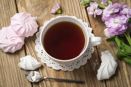 Cup of black tea with marshmallows, top view Stock Photo