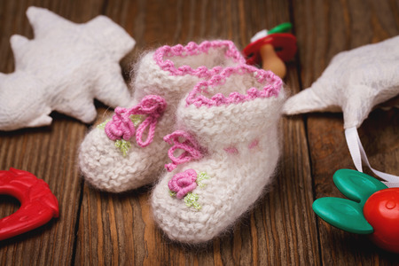 teether: Baby booties and toys Stock Photo