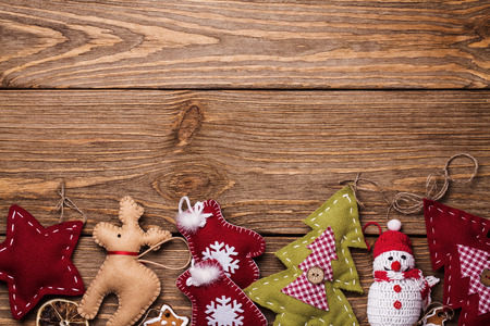 Christmas toy on a wooden table with space for text, top view