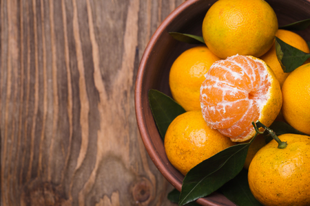 backcloth: Top view of a cup full of tangerines with space for text