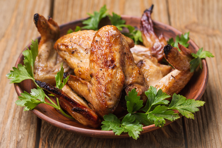 baked chicken: Plate with baked chicken wings Stock Photo
