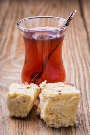Tea in a transparent glass and Turkish Delight Stock Photo