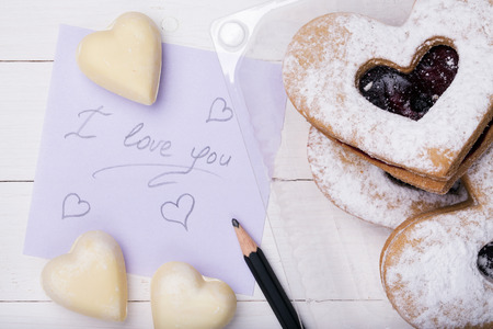 title emotions: Cookies in the shape of a heart and the words with a declaration of love Stock Photo