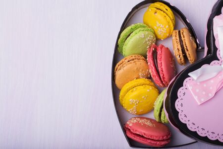 backcloth: French colorful macaroons in the box with space for text Stock Photo
