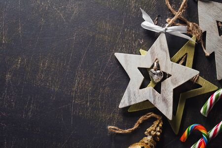 Decorative wooden pendants with bells and space for text. Top view of a Christmas decoration with candy